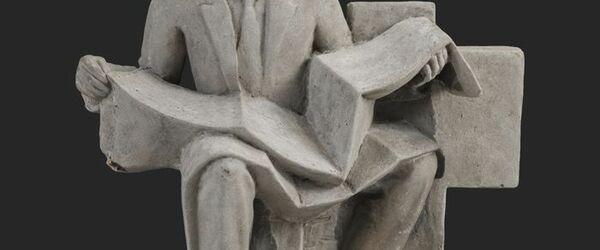 Cementen beeld 'de architect'