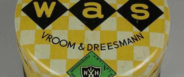 """Cilindrisch blik wrijfwas of meubelwas van """"VROOM & DREESMANN"""" met logo van de """"N.V.V.H"""""""